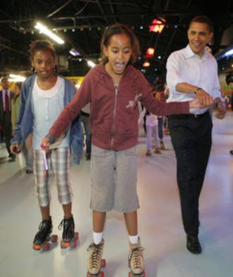 Democratic presidential hopeful, Sen. Barack Obama, D-Ill., right, helps his daughter Malia, center, roller skate at Great Skates Fun Center in Lafayette, Ind., Saturday, May 3, 2008. (AP Photo/Jae C. Hong)